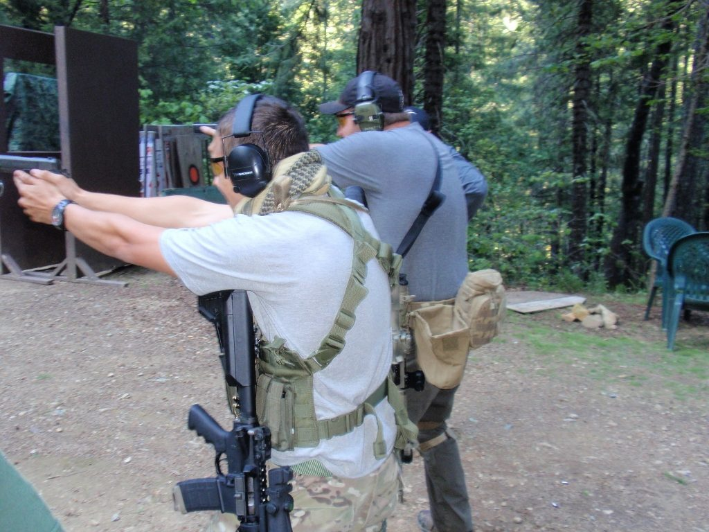students firing tactical rifle at range