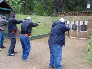 students firing at targets at gun range