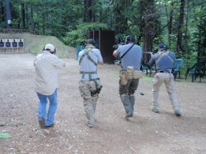 students firing tactical rifles at gun range